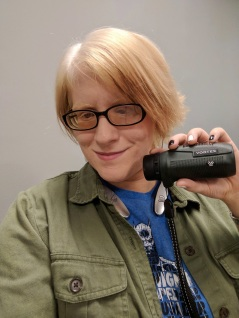 Person with Albinism showing off the Vortex monocular